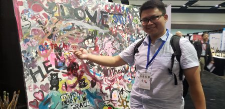 Tech Talk Coordinator Sunny Zhao leaves BizTech's signature at the Silicon Valley Innovation and Entrepreneurship Forum.