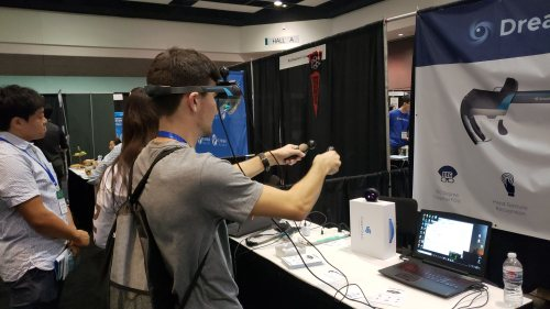 BizTech Vice President Dennis Karpovitch tries a new Augmented Reality product called Dream Glass at the Silicon Valley Innovation and Entrepreneurship Forum.